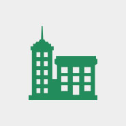green commercial building icon on gray background